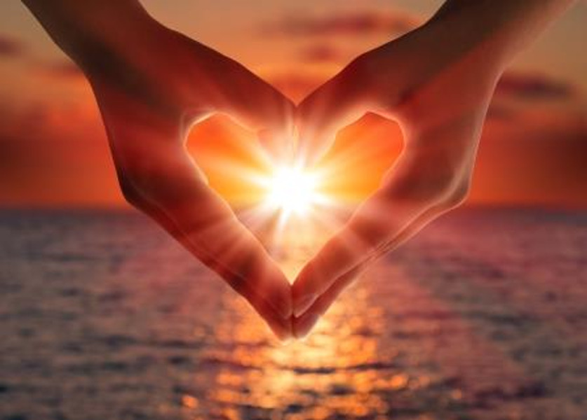 http://www.dreamstime.com/royalty-free-stock-photography-sunset-heart-hands-sea-image33939547